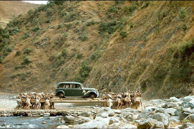 Porters transport a car across a stream, Nepal 1948 Old Nepal